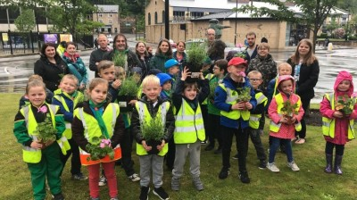 Green fingered youngsters help out with community planting project